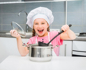 little girl in a cap chef