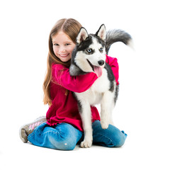 little girl is with husky dog
