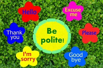 Be polite message on colorful flowers and green shrub background