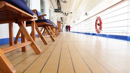 Pan of Senior Couple Taking Walk Deck of Luxury Cruise Ship