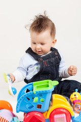happy baby playing with toys