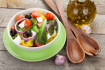 Fresh healty salad and kitchen utensils