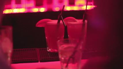 Barman preparing, serving drinks, cocktails, pub, bar atmosphere