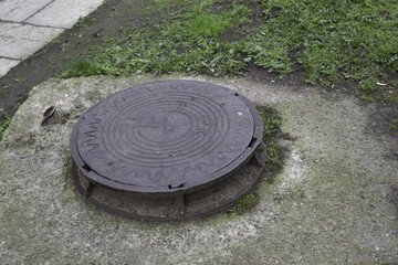 Sewer hatch with metal lid