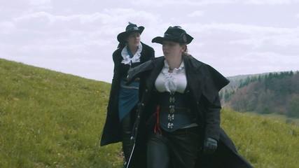 Two Female Shadow Hunters walking on field – Slow Motion