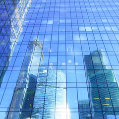Reflections of modern office buildings