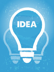 idea in bulb symbol with over blue grunge background