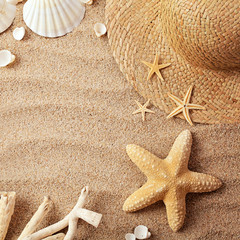 summer hat on sand and seashells. copy space background