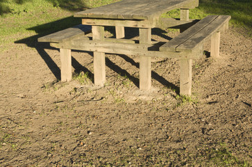 Wooden picnic table in field