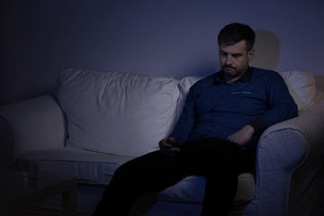 Lonely man spending evening alone
