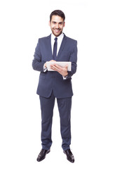 Handsome business man standing with tablet computer, isolated on
