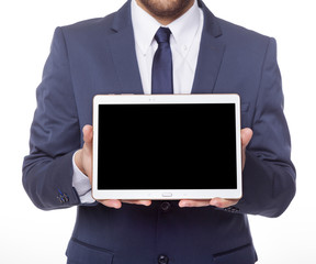 Businessman displaying a tablet computer, isolated on white back