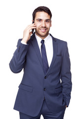 Smiling business man talking on the phone, isolated on white bac