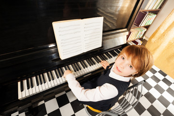 View from top of girl in uniform playing piano