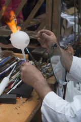 master working on a glass ball