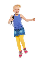 Cute small girl singing in microphone and dancing