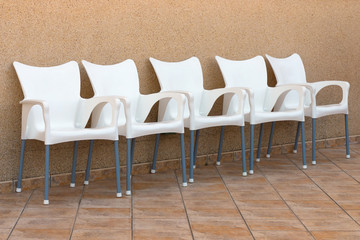 plastic chairs set in a row