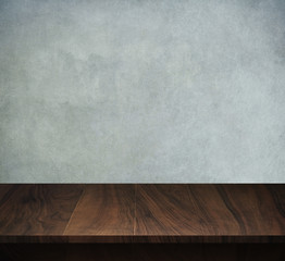 Wood table with loft concrete background