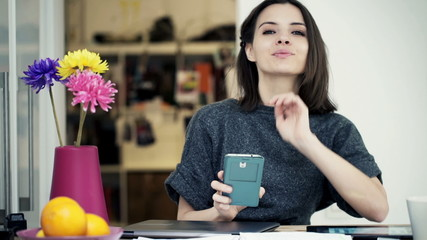 Portrait of pretty, happy businesswoman
