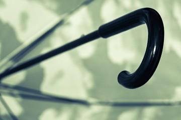 black green umbrella cane handle closeup