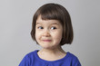 Постер, плакат: fun preschool girl making a face and enjoying humor