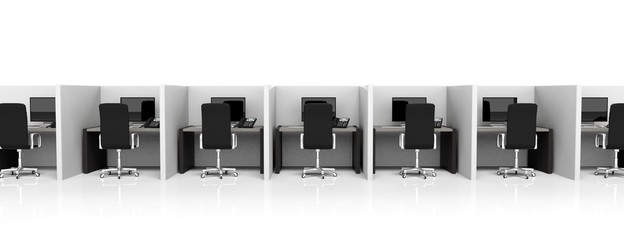 Office cubicles with equipment and black chairs