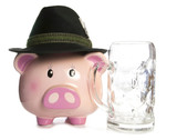 sad piggy bank wearing beer festival hat and empty pint