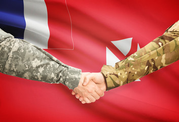 Men in uniform shaking hands - Wallis and Futuna