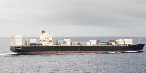 Large container cargo ship in the open sea