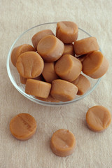 Toffee caramel candies in a glass bowl