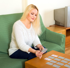 Woman playing solitaire at home