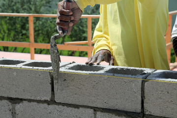 Bricklayer building a new wall for a house.