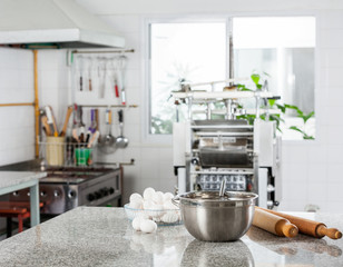 Mixing Bowl With Eggs And Rolling Pin In Commercial Kitchen