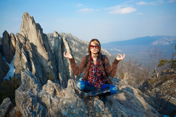 Woman meditating at the mountain top