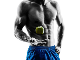 man exercising fitness exercises eating apple  silhouette