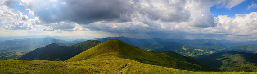 Panoramic sunrays mountains