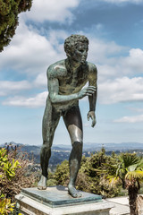 A statue of 'The Runner' in the garden of Achilleion