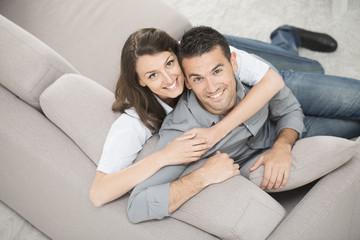 happy couple on a sofa