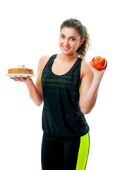 athletic girl holding a cake and apple