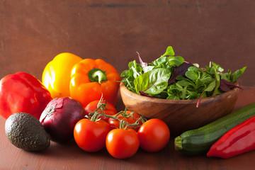 healthy vegetables pepper tomato salad onion avocado on rustic b
