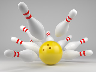 Yellow bowling ball and scattered skittles