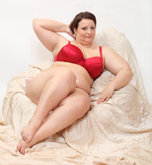 Overweight woman in the bedroom.