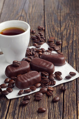 Coffee cup and chocolate candy