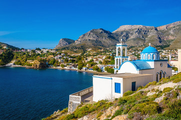 Typical for Greece white church with azure-blue dome