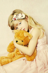 beautiful blond child with teddy bear