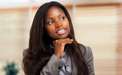 Young thoughtful black businesswoman portrait