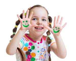 Little girl showing painted hands with funny face