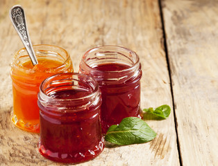 Two kinds of home-made jam from strawberry and apricot, selectiv
