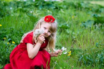 blond girl picking dandelions