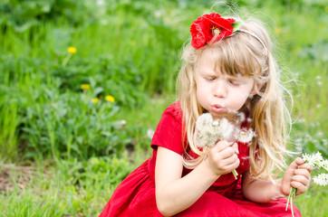blond girl blowing dandelion